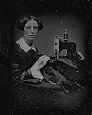 victorian photo of woman at sewing machine